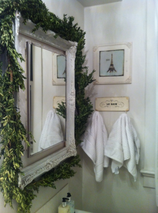 The mirror is from Greens Antiques (Cabbagetown, Toronto) and was painted white. The boughs around the mirror were put up for Christmas and she loved the so much she left them up.